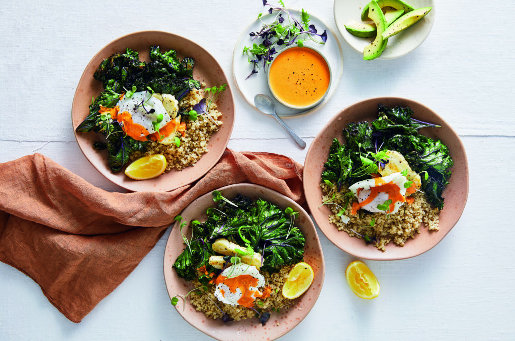 three bowls of vegetarian low-carb meals with another bowl with orange liquid on top.