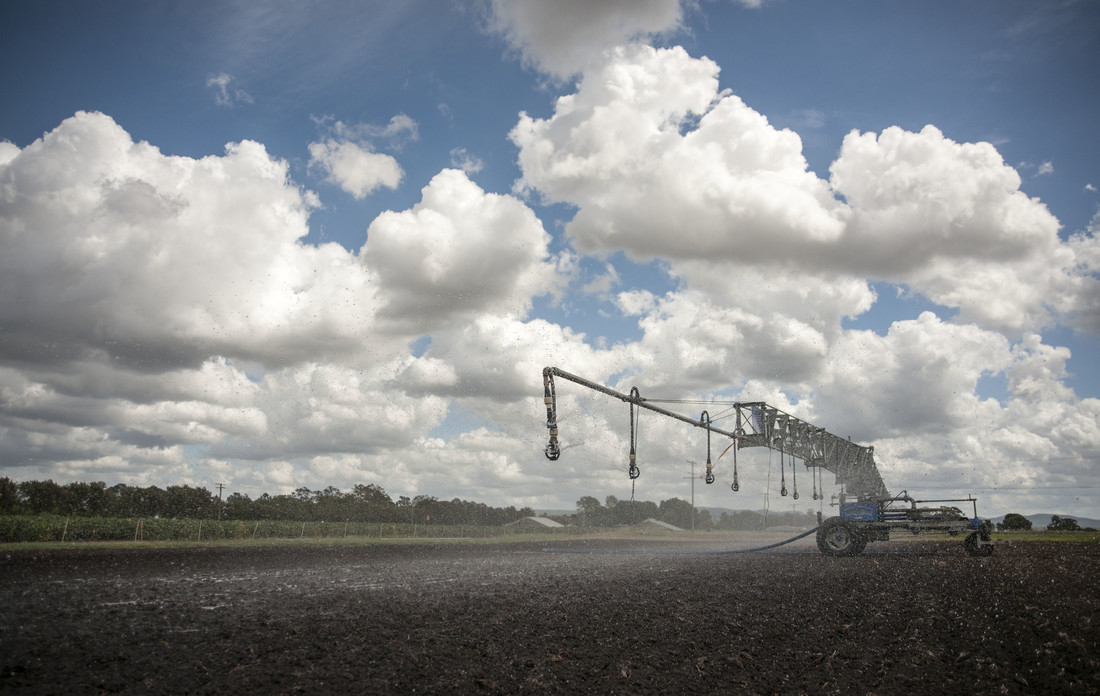 Photo of an irrigated farm being sprayed with water.
