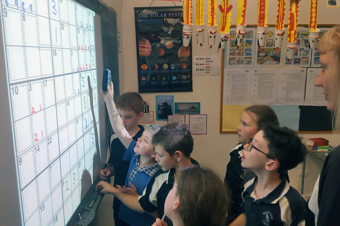 Image of students in a classroom playing Killer Sudoku