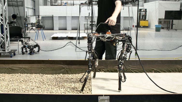 The DyRET robot walking from fibre-cement to gravel.