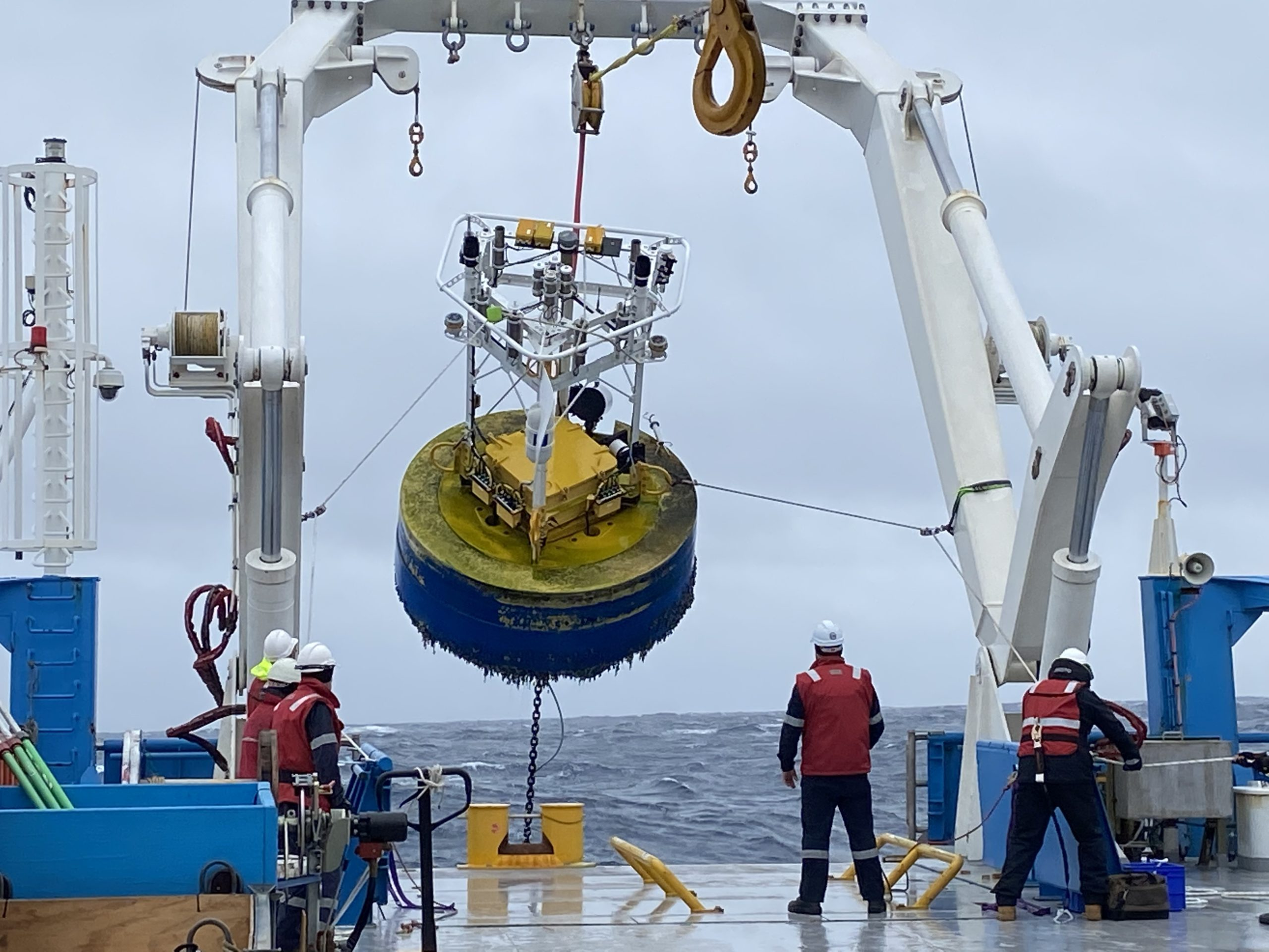 Scientists pulling up a sentinel from the Southern Ocean