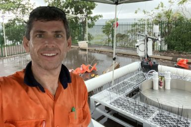 David McJannet smiling at camera with evaporation pan in background