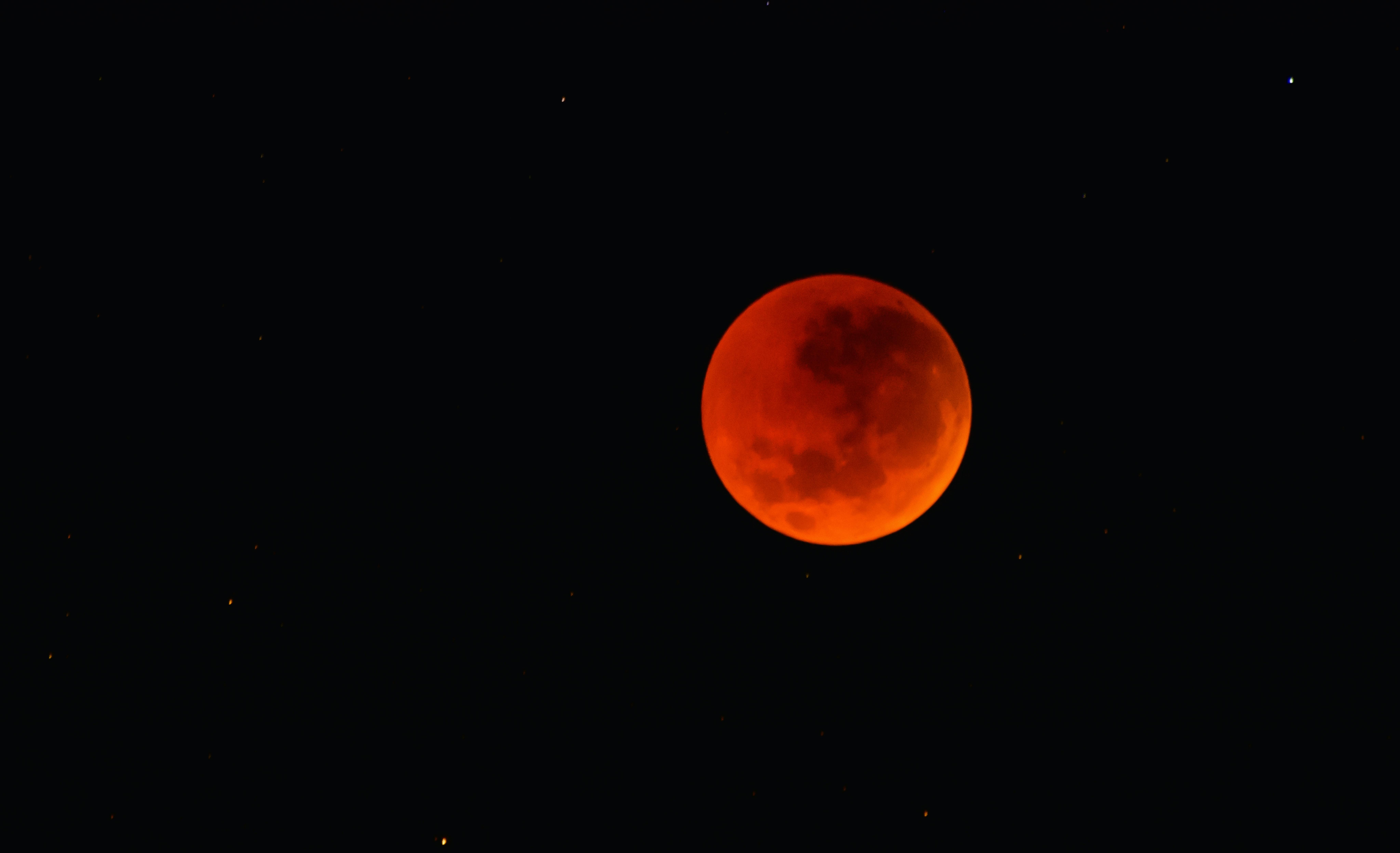 Total lunar eclipse (red moon) in black sky