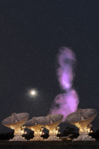 Radio telescopes with purple light going into the sky