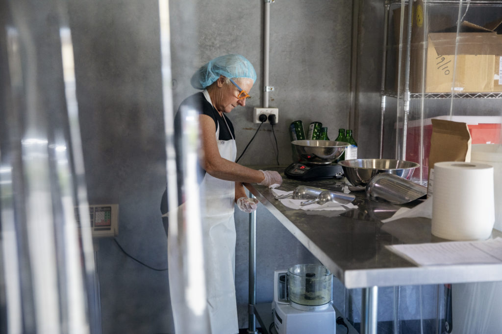 Image of person in a commercial kitchen.