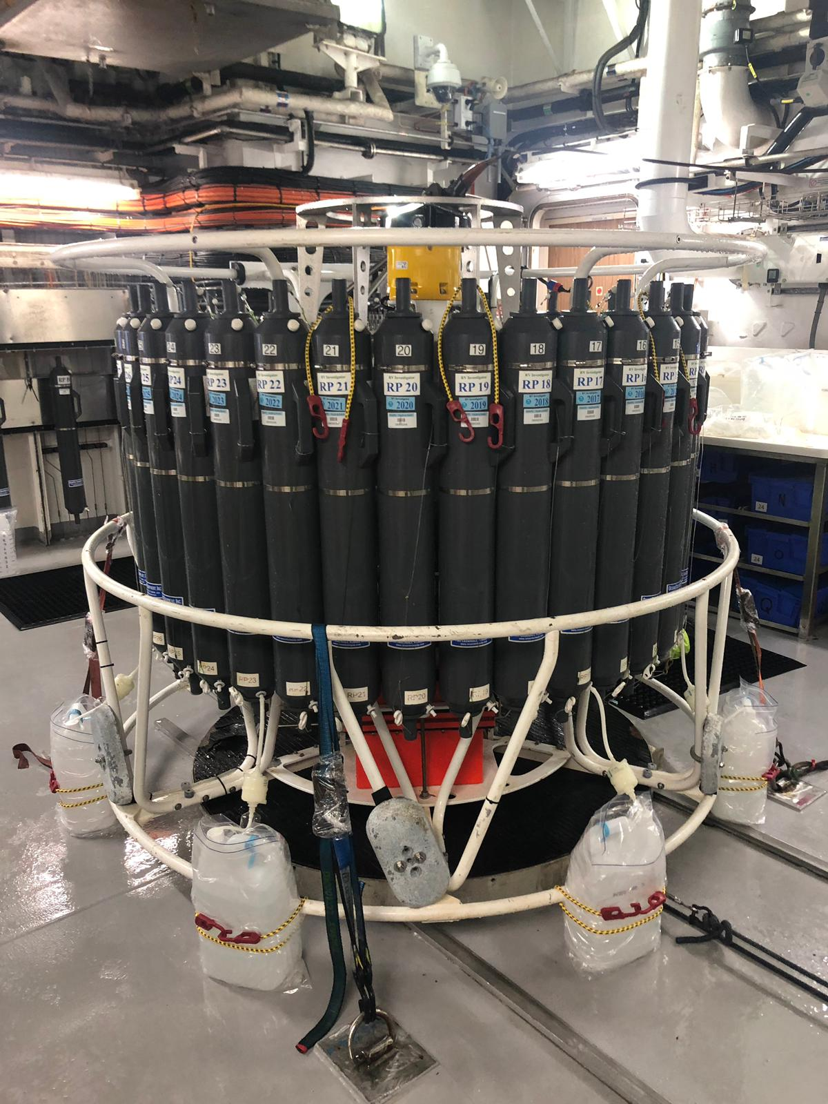 A piece of machinery that explores anaemic oceans. Its a bunch of black bottles in a circle with clear bottles at the bottom.