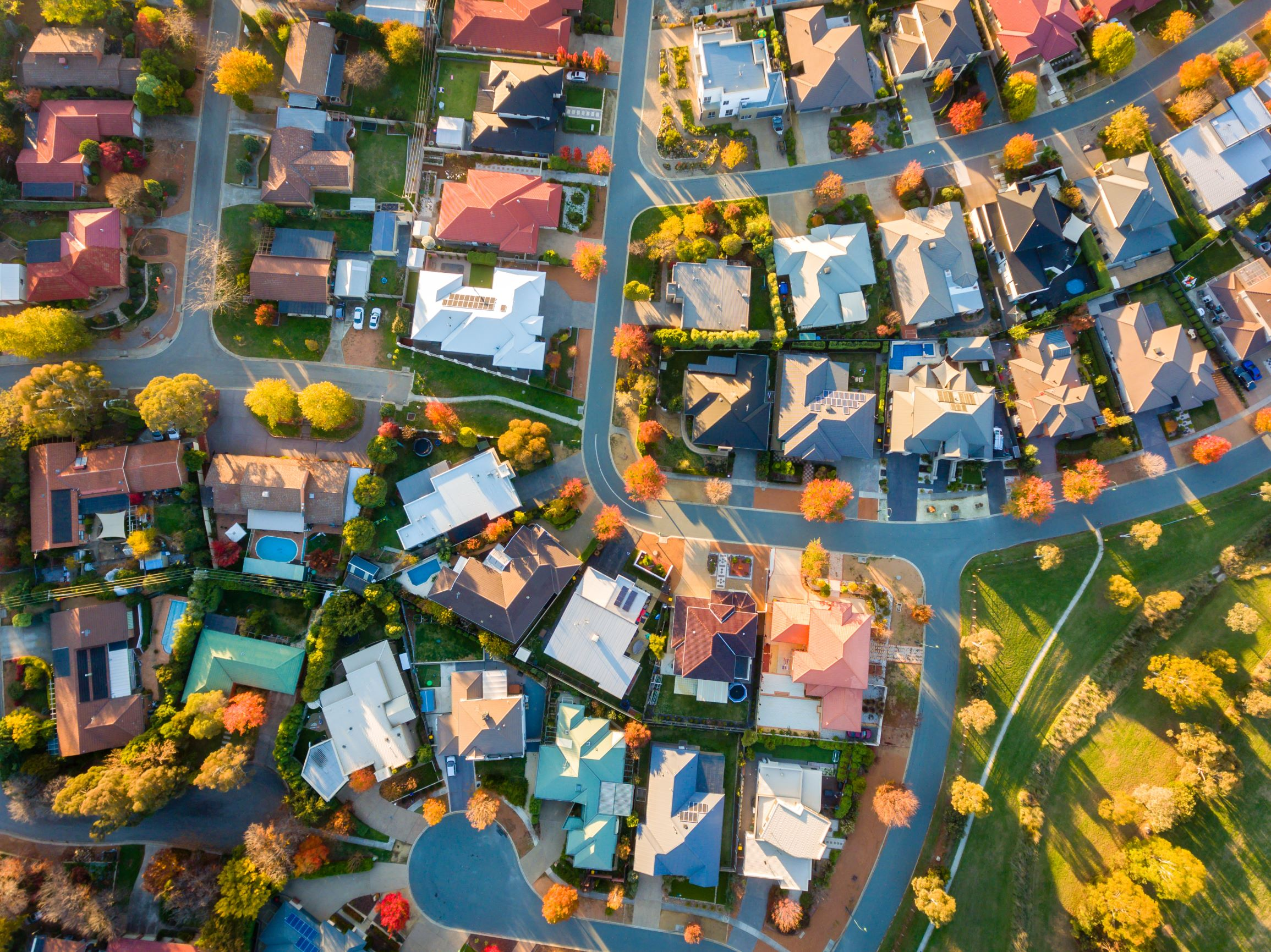 A drone shot of a suburb of houses.