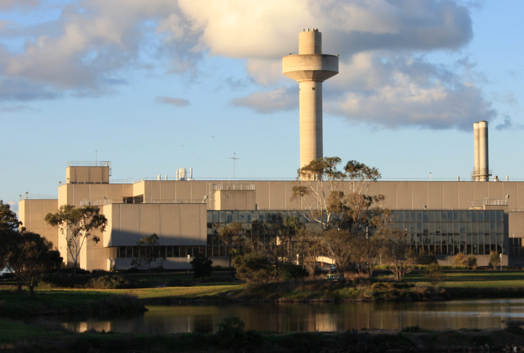 A large cream coloured building with a tall tower rising up from its roof is helping research abalone disease.