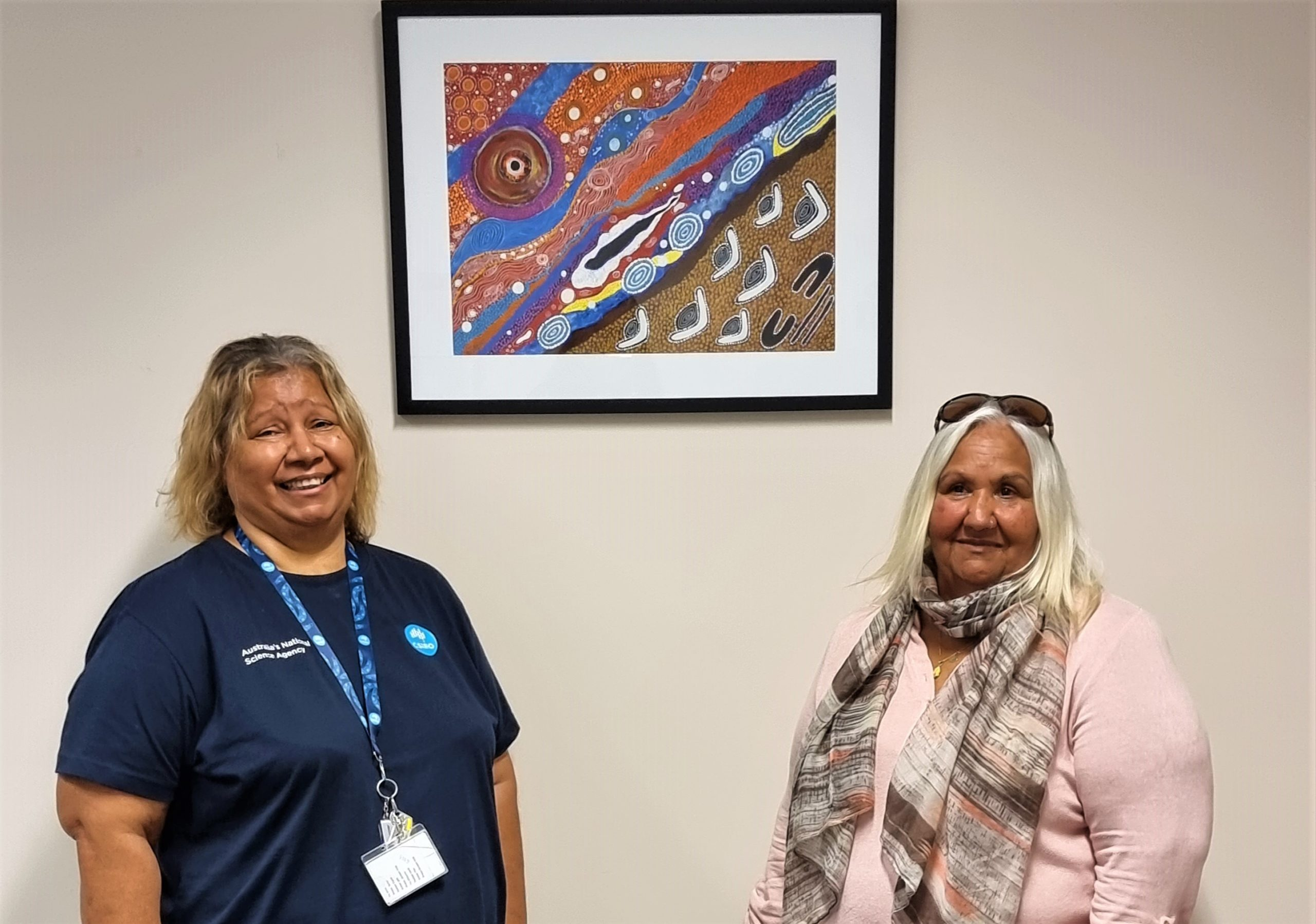 Margaret Whitehurst is photographed in front of her painting with CSIRO's Leonie Boddington.